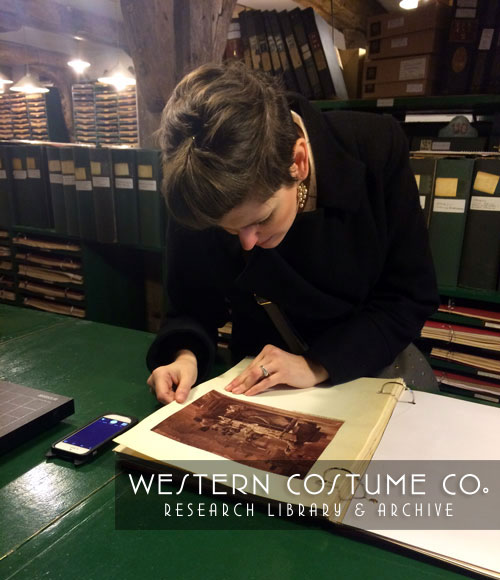 Looking At A Scrapbook At The Rotherhithe Picture Research Library